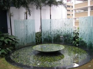 Water feature sandblasted glass panel