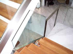 A template is used to custom cut the odd shape glass panel to ensure perfect fit